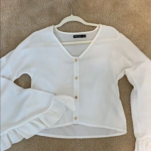 White button up top with bell sleeves